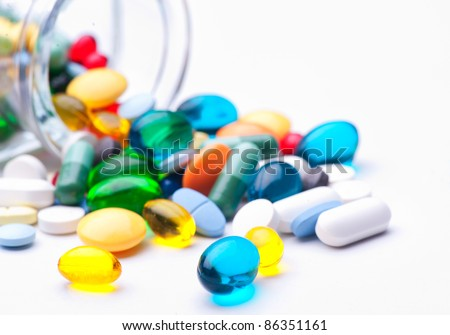 Many pills and tablets isolated on white background - stock photo