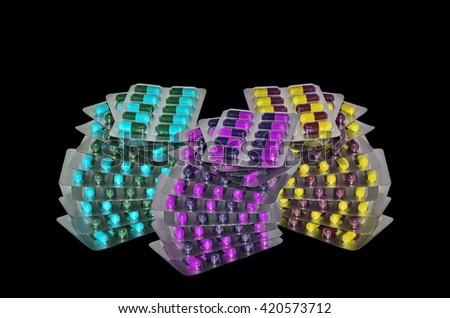 Many Pills in a blister pack on black background - stock photo