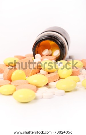 many pills spill out of the bottle