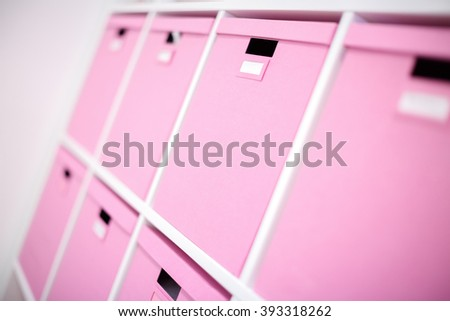 many pink boxes. shelves for storage - stock photo