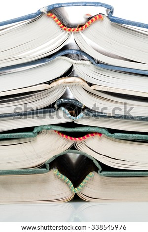 Many pitched books are placed in a stack - stock photo