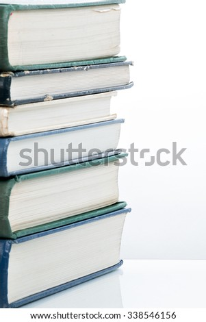 Many pitched books are placed in a stack