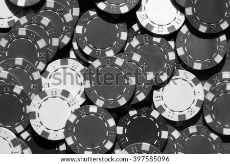 Many poker chips. Many old poker chips. Many color poker chips background. closeup. Background created with casino chips. Chips background. Black and white photo.