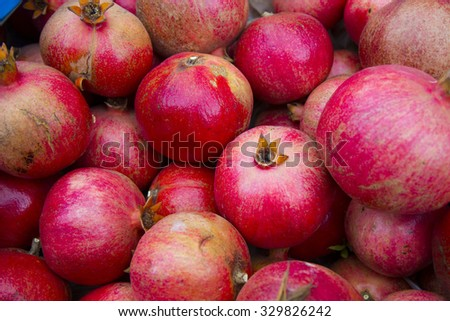 Many pomegranate fruits â?? red delicious