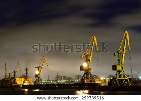 Many port crane in wintertime at night, Saint - Petersburg, Russia - stock photo