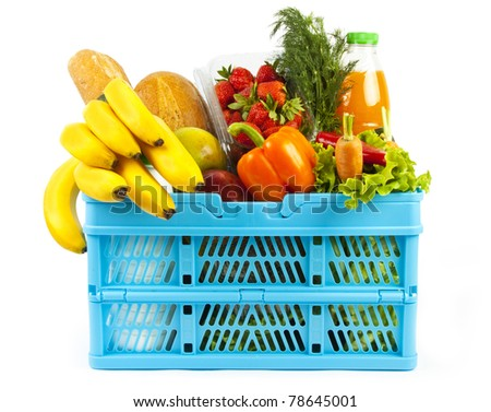 Many products in shopping basket isoleted on white background - stock photo