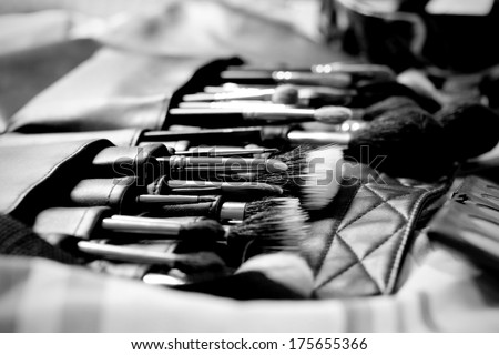 Many professional cosmetics for make up, black and white - stock photo