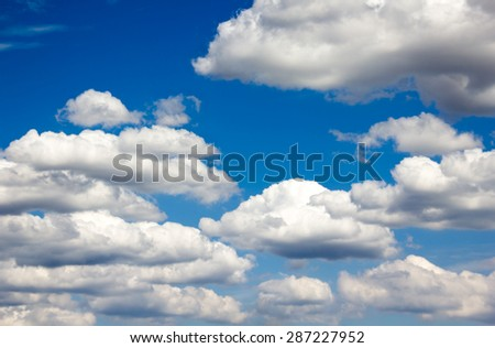 Many puffy clouds blue wide dreamy sky background and relax feeling - stock photo