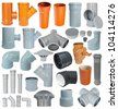 many pvc draining fittings in a set, isolated - stock photo