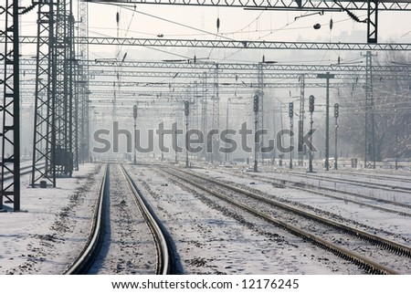 Many railway tracks in winter - stock photo