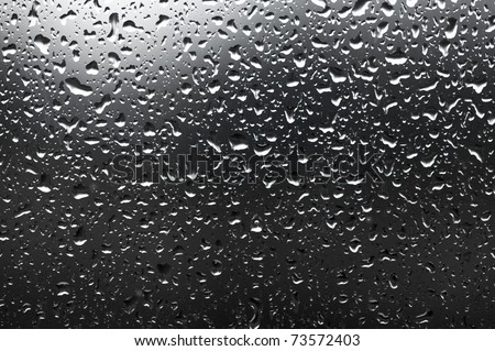 Many raindrops on a window - stock photo