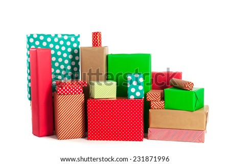 many red an green gifts with jute bag isolated over white background - stock photo