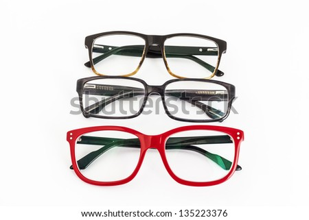 many red and black eyeglasses with white background