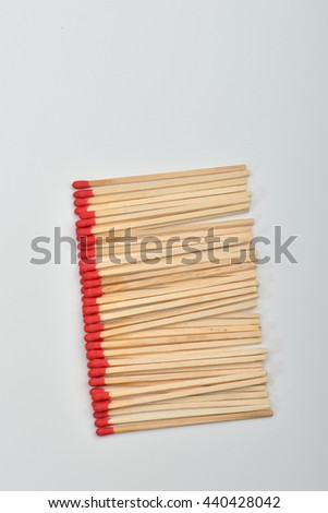 Many red head matches put straight in line on white background