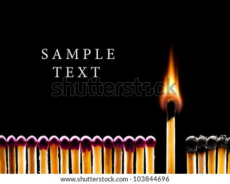 Many red matches on a black background (one match burns). - stock photo