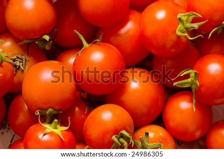 Many red tomatoes arranged at the market - stock photo