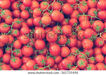 Many red tomatoes at farmers market stall. - stock photo