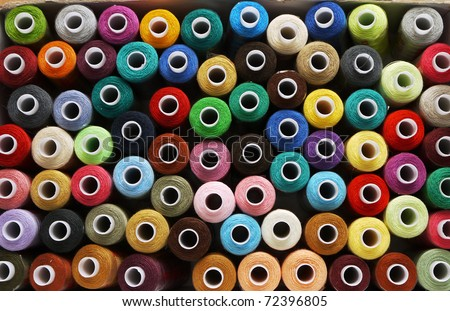 many reels of threads for embroidery, colorful, background - stock photo