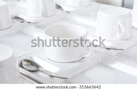 many rows of coffee or tea cups for background. - stock photo