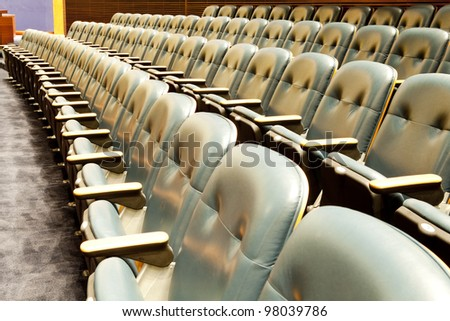 Many rows of red chairs at the empty theatre - stock photo