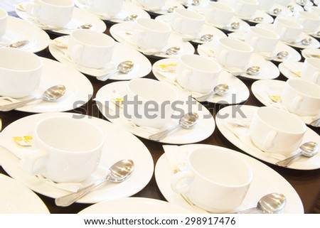 Many rows of white ceramic coffee or tea cups. - stock photo