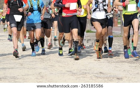 many runners run in the outdoor race, motion blur - stock photo