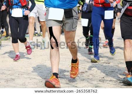 many runners run on the road while riding in a race, motion blur - stock photo