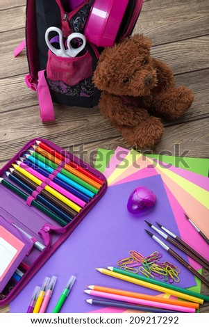 Many school stationery, school bags, teddy bears, a heap - stock photo