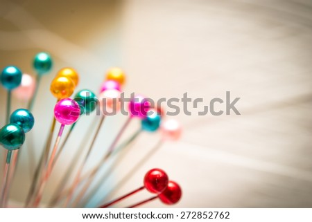 Many sewing push pins on Spool of Thread ,vintage style,Blur picture style - stock photo