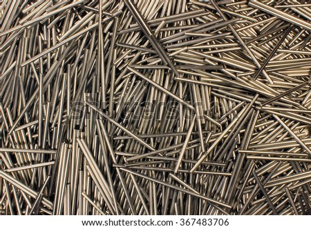 Many shiny metal round bars as background - stock photo