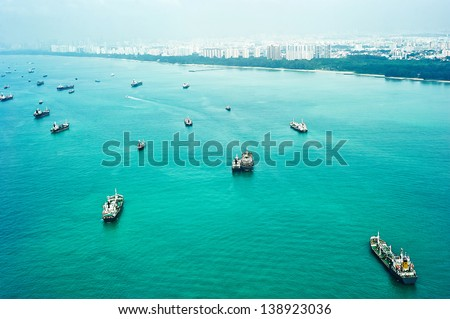 Many ships in Singapore harbor. Aerial view