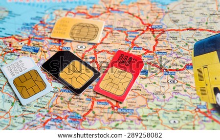 many sim cards with the europe map on background - stock photo