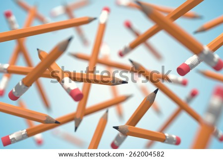 Many simple pencils chaotically flying in air - stock photo