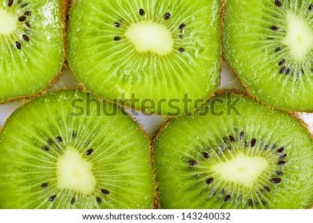 Many slices of kiwi fruit - stock photo