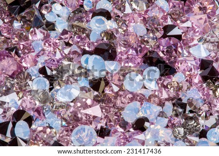 Many small diamond jewel stones, luxury background closeup