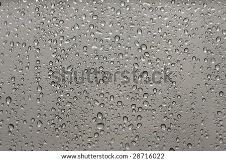 Many small raindrops on a transparent surface - stock photo