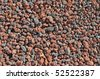 many small red stones granules, background, texture - stock photo