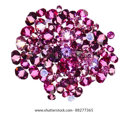 Many small ruby diamond (jewel) stones heap isolated on white - stock photo