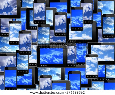many smart-phones and tablets with image of blue sky