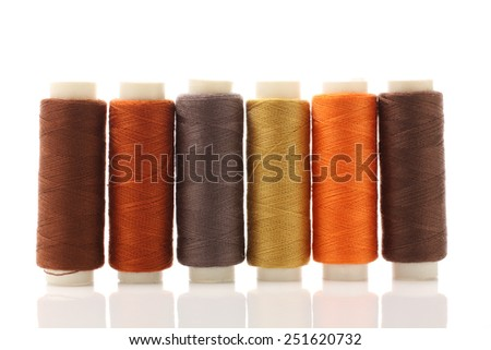 Many spools of thread isolated on white background - stock photo