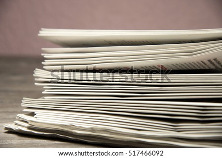 Many stacked newspapers