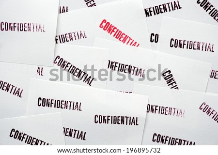 many stamped confidential on white paper - stock photo