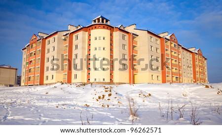 Many-storeyed, multiroom apartment house. A winter season - stock photo