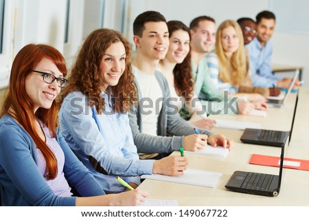 Many students studying in a seminar of an university - stock photo