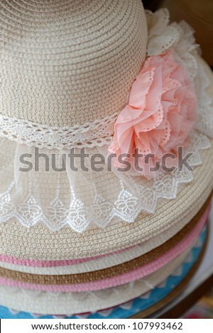 many summer hats in a shop. - stock photo