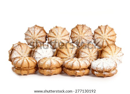 Many sweet cookie with flour over it on white background. Sanding in three lines - stock photo