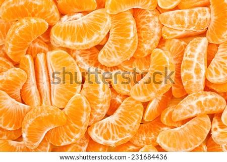 many tangerine slices for background use - stock photo