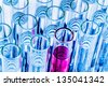 many test tubes in a test in a research laboratory of a university. symbol photo and learn for research. - stock photo