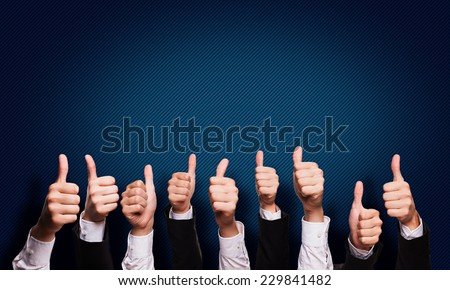 many thumbs up - stock photo