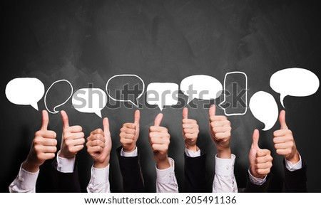 many thumbs up with speech bubbles - stock photo